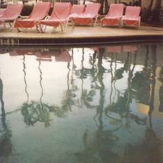 reflections... Pink lounge chairs poolside
