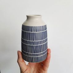 This is the same vase I showed you a couple of posts back. Here's how it looks after its final firing - the blue becomes a lovely rich navy and the bare clay a crisper white. I finish it off with a matt transparent glaze which feels wonderfully smooth and is light enough not to smother any of the sgraffito texture.