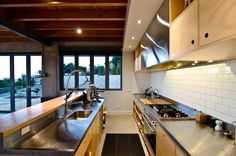 Commercial style kitchen that can be adapted to suit any home made in Hoop Pine plywood with Stainless steel worktop. A very robust kitchen