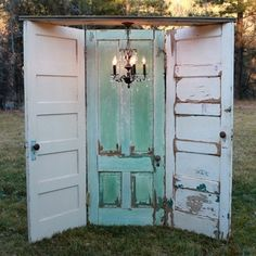 3 old doors hinged together makes a unique ROOM DIVIDER. With a chandelier hanging above, makes a pretty vignette for a store display. Could be a photo prop background for vintage wedding or used for a trade show or craft booth display. Diy Wedding Photo Booth, Wedding Ideas, Rustic Photo Booth, Trendy Wedding, Wedding Photos, Home Made Photo Booth, Wedding Themes, Wedding Dresses, Party Photos