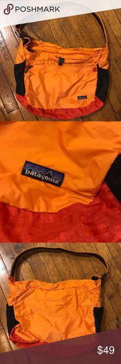 Patagonia Lightweight Travel Courier! These are the absolute best bags for travel, the gym, or just running around town! I simply have too many and need the closet space! Awesome, no longer available light orange on red-orange color combo. Crossbody strap easily adjustable. One interior zip pocket. The whole thing folds into the front zipper pocket and it has a built-in keychain. Two side stretch water bottle holders. Top has drawstring closure too! Patagonia Bags