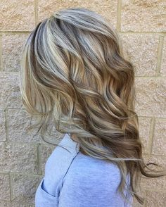 Cool blonde highlight with rich lowlights mixed throughout