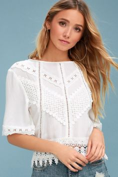 Feel the romance in the air with the White Crow Gracie White Crochet Lace Tie-Back Top! This lightweight, woven rayon top features a rounded neckline, short sleeves, and a relaxed bodice. Chic crochet lace decorates bodice, sleeves cuffs, and hem, plus pierced crochet details at front. A cute tie back detail completes the femme look.
