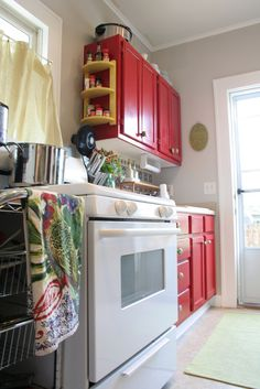 Love these Red cabinets...maybe in the laundry room.