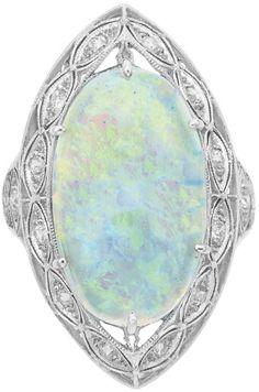 Edwardian Platinum, Opal and Diamond Ring  One oval opal ap. 4.50 cts., c. 1910, ap. 4.7 dwt. Size 7. Via Doyle New York.