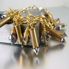 Bullet casing jewelry. I love these!!! I just have to find a way to drill the tiny holes in the top of the 22.