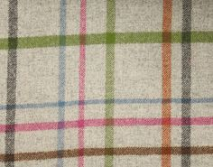 A wool plaid in light grey with a multicheck in cerise pink, green, turquoise, charcoal and brown. Made in the UK