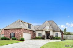 This large and inviting 4 bedroom, 3 bathroom home in Forest Ridge Subdivision has it all! Plus, it offers convenient access to I-12 and the new Juban Crossing shopping center. Amenities include beautiful stained/stamped concrete floors, granite counter tops, stainless steel appliances, a cozy gas fireplace, built-in book shelves, a covered back patio, fully fenced yard, and the split floor plan offers privacy for the master suite. NO Flood insurance required, and qualifies for 100% RD…