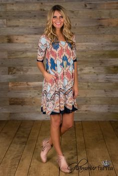 Carson Paisley Elbow Length Dress is bold color, classic styling! This swing style dress is eye-catching with an all-over paisley print. Scoop neckline, elbow length sleeve and hidden side pockets. Th