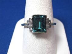 This is a truly fabulous Art Deco tourmaline diamond ring, set in platinum. Blue green tourmalines are increasingly hard to find and this one is a