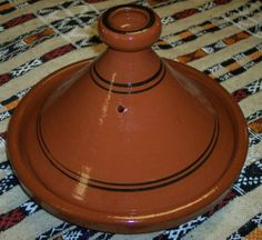 Moroccan extra large wave Tagine Free Shipping By Treasures of Morocco by Hand Made. $69.99. Imported from Morocco with a Free Shipping. the food is always moist and delicious. Ideal for cooking on top of any kind od stove. Cook Chicken, Meat, Seafood or Vegeterian food. Measurement: 13 inches wide (at base). Simple and functional, this authentic, handcrafted Moroccan cooking Tagine is ready to be used for your next flavorful and exotic Moroccan meal.The Tagine ...