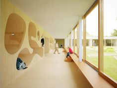 Knokke-Heist School Building by NL Architects - single loaded corridor - overlooking courtyard