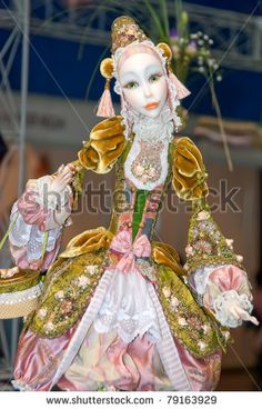 KIEV, UKRAINE - MAY 22: A collectible doll, which resembles a harlequin, is on display at the Kyiv Fairy Tale exhibit in the 2nd annual International Doll Salon on May 22, 2011 in Kiev, Ukraine. by Kavun Kseniia, via ShutterStock