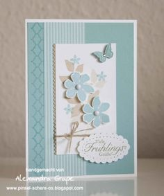 lovely colours and textures with stamped border behind DSP and edgelits. nice with flowers fussy cut