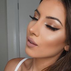 Pretty winged eyeliner with nude eyeshadow.