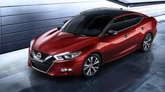 Nissan Maxima Platinum in Coulis Red.