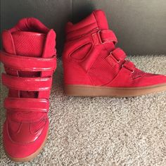Red Wedge Aldo Sneakers Red Wedged Aldo Sneakers. Slightly worn. Still good condition. Very comfortable Wedge Heel. ALDO Shoes Sneakers