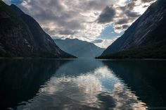 Hourglass of light. The Hardanger fjord, Norway. Photo by Thibault Delemotte.