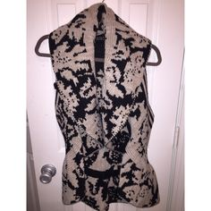Sleeveless/Peplum Cardigan Sleeveless and Reversible Cardigan. Great to pair with jeans and boots! Sweaters Shrugs & Ponchos