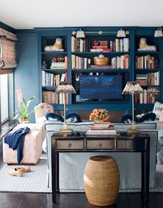 love this living room color and setup    thefoodogatemyhomework:    Prussian blue den/family room/library on the Upper East Side by Ashley Whittaker. Love the grasscloth walls matching the blue millwork and built-ins. There are lots of fine things in this room, but it's not so precious that you can't seriously kick back and relax - as exemplified in this photo. Wonderful design.