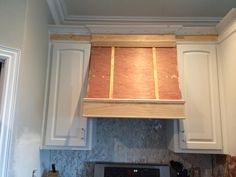 "Creating a statement piece in a room is a great way to bring ""wow"" into a space. For my kitchen, I wanted the range hood to be the focal point. Once a builder grade set of cabinets, no the range is a bronze beauty - thanks to paint and inexpensive tacks."
