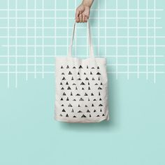 """Totes are that universal product that everyone needs and uses. A book bag, a grocery bag, or just somewhere to throw in all of those little everyday items.  100% Bull Denim Woven Cotton construction Dimensions: 14 3/8"""" x 14"""" (36.5cm x 35.6cm) Dual handles Fabric weight 11.0 oz/yd² (373 g/m²) Superior screen printing results A cute, all-purpose natural cotton geometric tote bag."""