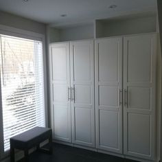 IKEA Pax wardrobes - cleverly built in with top shelves