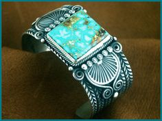 Turquoise Cuff - Might be the work of Sunshine Reeves. I can't track the original source.