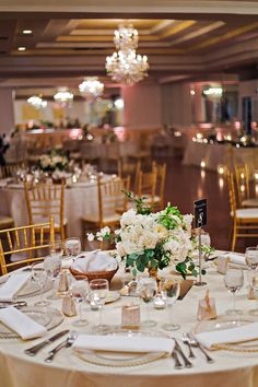 White, gold and green winter wedding decor - classic ivory linens and gold chiavari chairs accented the banquet tables {Cesar Chavez Photography}