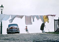 John Bulmer - a good street photographer captures the moment and tells a story.  Your glance skims across the photo and then stays looking at the details and thinking about the image.