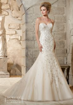 Mori Lee Wedding Dress 2790, Ivory, size 10. Diamante and Swarovski Crystal Beaded Embroidery Cascades Over the Net Gown