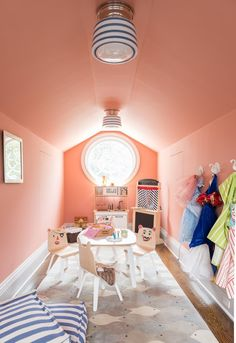 Playful kids attic playroom space in Farrow and Ball, Red Earth paint and blue and white striped furnishings // favorite paint color // calm paint color // paint color for playroom // paint color for whole house