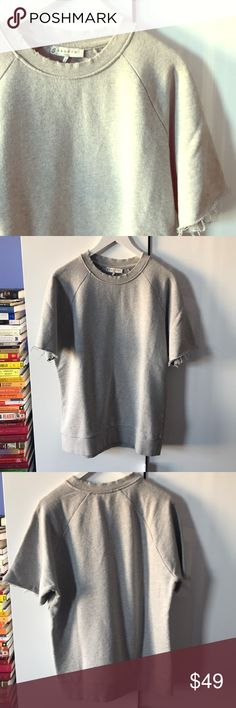 NWOT Sandro Distressed Sweatshirt A classic wardrobe basic with a twist from every French chic girl's favorite brand, Sandro. This short sleeve sweatshirt is intentionally distressed, Tags are removed but top was never worn. Size not marked but I'd say lost like a L/XL Sandro Tops Sweatshirts & Hoodies