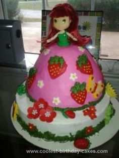 Homemade Strawberry Shortcake Doll Cake: I used the Wilton wonder mold for the Strawberry Shortcake Doll Cake dress.  The strawberries were made from mm fondant along with the flowers on her dress.