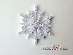 This snowflake would be a wonderful little present for a friend. It comes with a gift box. The ornament is ideal for Christmas decoration, party favor, gift topper and more. The snowflake is all handmade in quilling technique, also known as paper filigree. I used 4mm paper strips in