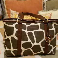 """MK BAG Excellent  condition. Only flaw I see is a small scratch in the button closure in the picture. Clean inside and outside. 14"""" side to side 10"""" height and 5"""" width in the bottom. TV $350. Only took to work one time. Do not see anything wrong in the leather handle and portion of the bag. No dust bag. Will trade for MK watch etc. Michael Kors Bags"""