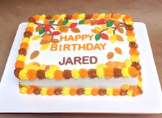 Double layered sheet cake fall and autumn themed design.