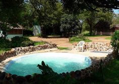 Amanzimlotzi Riverside Bush Camp Hoedspruit Located on a small private reserve at the Klaserie river, Amanzimlotzi Riverside Bush Camp offers rustic accommodation in the Greater Kruger Park area. Outdoor Pool, Outdoor Decor, Game Reserve, At The Hotel, Hotel Offers, Bungalow, South Africa, Camping, Explore