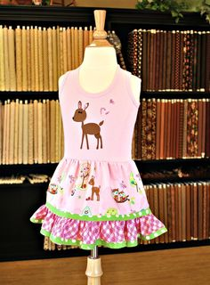Dress made with a tank top, add a skirt, some embellisments and voila! you've got a great gift for a little girl.  Scroll down the page for the tutorial