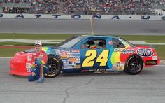Jeff Gordon poses alongside of his No. 24 DuPont Chevrolet at @DISupdates in 1993, his rookie season.