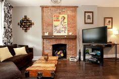 frame fireplace wall brick, chunky wood mantel, ignore the bad artwork; like the table too