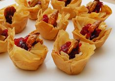 Cranberry Brie Bites 5 pieces phyllo dough 12 pecans 2-3 ounces brie 6 tsp cranberry sauce about 2 tsp olive oil or melted butter