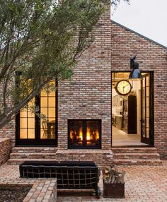 The exterior of Industrial houses usually have brick. This house has brick walls and a brick floor. It has big iron windows. In the house there is a big industrial clock that ties the indoor to the outside. Design Exterior, Patio Design, Exterior Paint, Design Design, Design Ideas, Future House, My House, Outdoor Fire, Outdoor Living