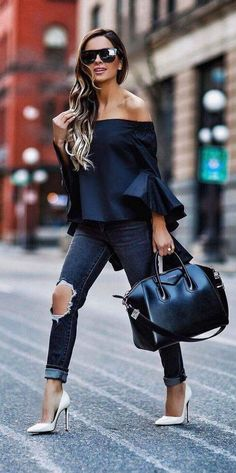 Shoulder-off tops are very cool. She is wearing skinny jeans. This is beautiful combination