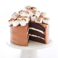 We transformed a classic mug of Hot Cocoa into a rich chocolate layer cake with marshmallow crème filling, cocoa frosting, and a mountain of marshmallows.