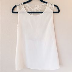Elegant, ivory and lace top Dreamy Ivory sleeveless top with lace detail on the back. Smooth satin look in the front. Zip on the side. Forever 21 Tops Tank Tops