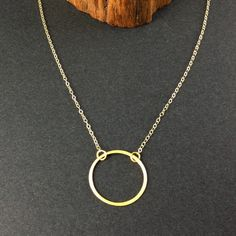 a simple gold necklace, maybe slightly less dainty than this?