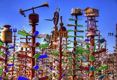 """Bottle Trees Historic Route 66 Highway Folk Art.   """"This art dedicated to those who have lived and died on the Mother Road.""""    Inscription on the Bottle Tree Ranch at Elmer's Place along the old Route 66 Hwy between Barstow and Victorville, California.  For my friend Kathryn!"""