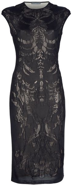 Black knitted silk blend pencil dress from Alexander McQueen featuring skeleton lace pattern, a nude underlay, round neck and short cap sleeves.