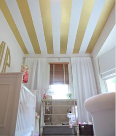 and Gold Stripe Nursery Gold Striped Ceiling in this Pink and Gold Nursery - so glam!Gold Striped Ceiling in this Pink and Gold Nursery - so glam! Gold Baby Nursery, Striped Nursery, Baby Girl Nursery Decor, White Nursery, Nursery Monogram, Gold Striped Walls, Striped Ceiling, Gold Kindergarten, Whimsical Bedroom